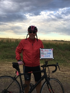 Al standing in front of a beautiful Oklahoma sky at the start of the nineteenth day of Pink Pedals 4 A Cure | Terry's Ride 2018.